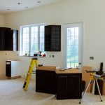 kitchen cabinets with no countertop in a kitchen renovation
